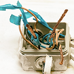 photo of exposed electirical wires in a box