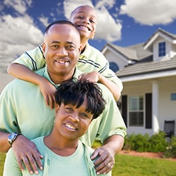 photo of a famiily in front of a newly purchased home